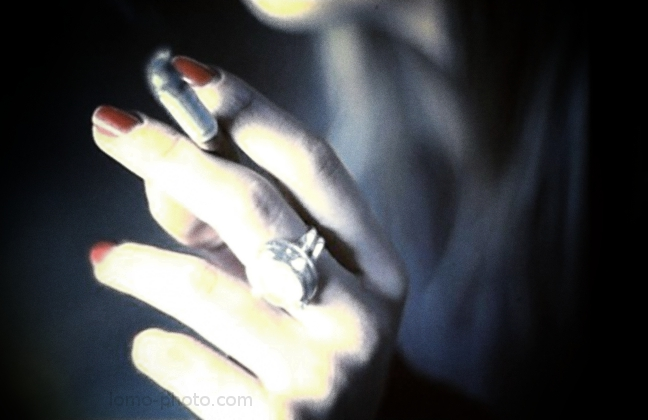 red nailpolish, jewellery and a cigarette